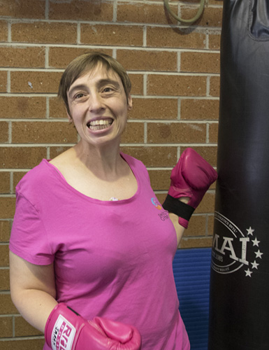 A woman in boxing gloves